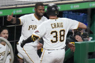 Pittsburgh Pirates' Will Craig (38) is greeted at the dugout steps by Gregory Polanco after getting his first major league hit, a solo home run, off San Francisco Giants relief pitcher Camilo Doval during the eighth inning of a baseball game in Pittsburgh, Thursday, May 13, 2021.(AP Photo/Gene J. Puskar)