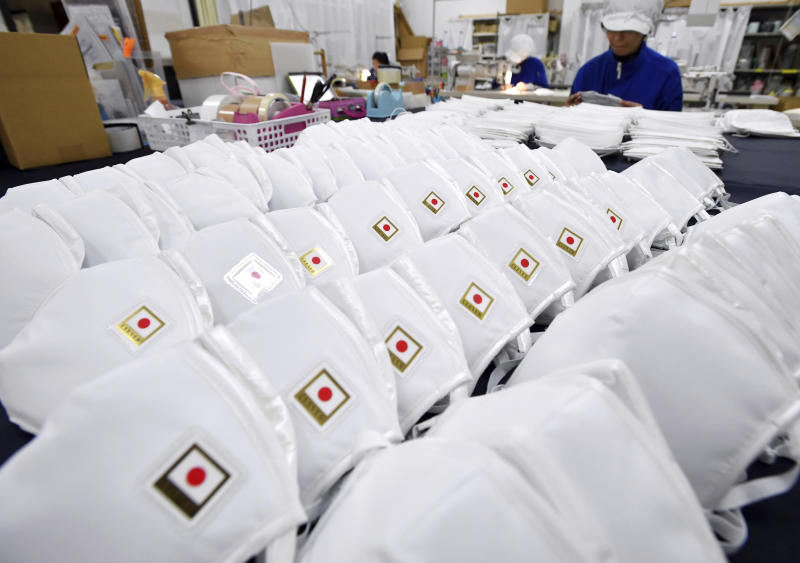 Workers are busy making high-quality masks at Kurebaa Company Office in Toyohashi, Aichi Prefecture on Jan. 23, 2020. Source: The Yomiuri Shimbun via AP Images