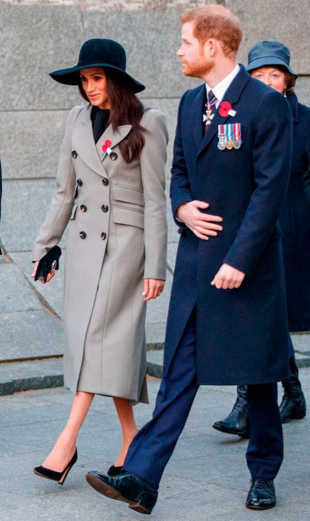 <p>Prince Harry and Meghan Markle attended the Anzac Day Dawn Service on 25 April 2018. For the occasion, the 36-year-old opted for a double-breasted coat by Canadian brand Smythe with a wide-brimmed hat. She accessorised the look with £282 Sarah Flint heels and a £625 Gucci bag. <em>[Photo: Getty]</em><br></p>