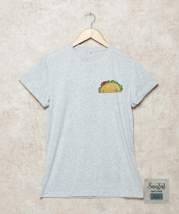 """<a href=""""https://www.etsy.com/listing/485153377/tacos-shirt-tacos-pocket-shirts-tee?ga_order=most_relevant&ga_search_type=all&ga_view_type=gallery&ga_search_query=taco&ref=sr_gallery_34"""" target=""""_blank"""">Shop it here</a>."""