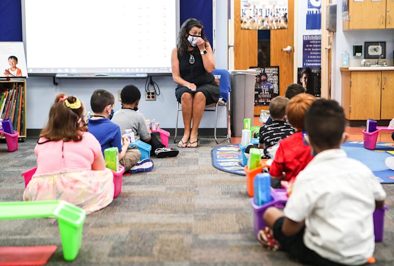 Lori Savage talks to her first grade class at S. Ellen Jones in New Albany, Kentucky, on the first day of school in August since the coronavirus pandemic shut down in-class teachings earlier in the year.