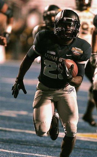 Utah State's Kerwynn Williams (25) runs for a touchdown against Toledo in an NCAA college football game on Saturday, Dec. 15, 2012, in Boise, Idaho. Utah State went on to win the Famous Idaho Potato Bowl game 41-15. (AP Photo/Matt Cilley)