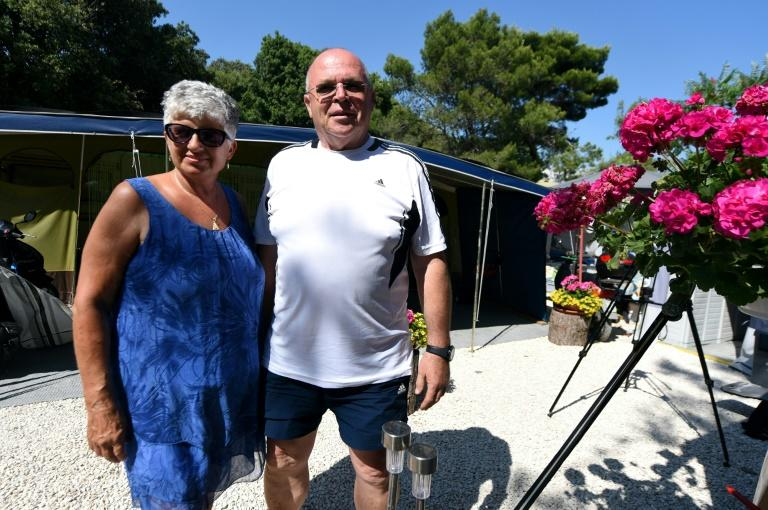 Dusan and Katarina Salomon, who live in Germany, have been visiting Croatia's largest naturist camp for nearly 50 years Dusan and Katarina Salomon, a Slovenian couple who live in Germany and have visited Koversada for nearly 50 years, pose on June 20, 2019, in front of their camp trailer at Koversada, Croatia's largest naturist campsite, on an islet off the northwestern Istria peninsula, near the city of Vrsar.Koversada opened in 1961 as Europe's first commercial naturist camp. Nowadays Koversada sees some 5,000 tourists at a time, in tents, camping vans or indoor apartments. Yet that is a far cry from its heydey in the 1980s, when it would welcome up to 15,000 campers daily. As an early pioneer of nudism, Croatia's idyllic Adriatic coast has a long and storied history of people stripping down to swim and commune with their surroundings in the naturist tradition