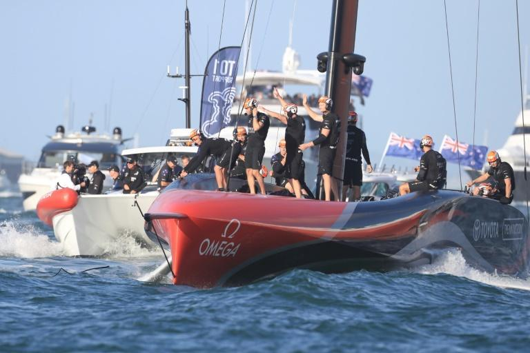 Team New Zealand's victorious crew lead a flotilla into Auckland Harbour as they celebrate victory in the 36th America's Cup against Luna Rossa