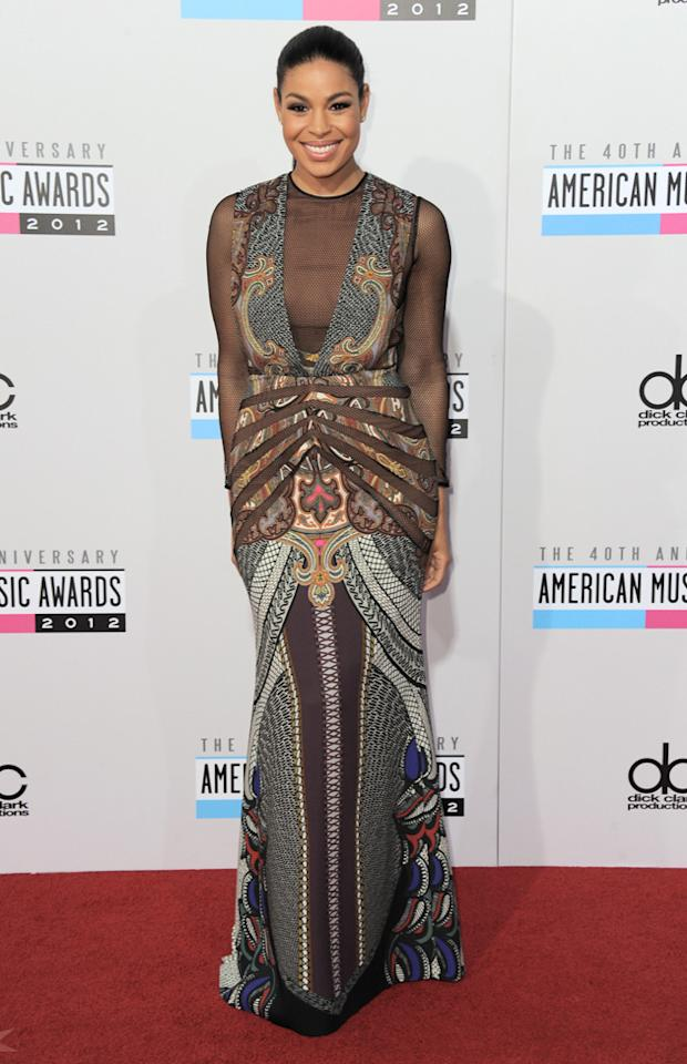 AMAs 2012: Jordin Sparks may have an amazing voice, but we think she got dressed in the dark. That netting! That pattern! No accessories! Argh, we need al lie down to recover from this fashion fail. Copyright [WENN]