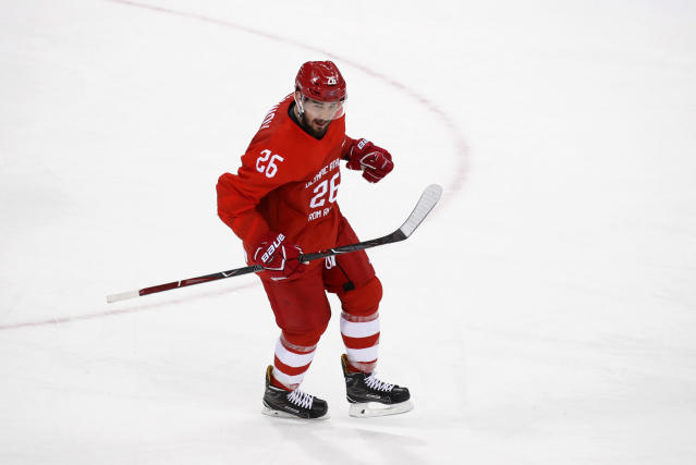 FILE - In this file photo taken on Sunday, Feb. 25, 2018, Russia's Slava Voynov celebrates after scoring a goal during the first period of the men's gold medal hockey game against Germany at the 2018 Winter Olympics in Gangneung, South Korea. Former Los Angeles Kings defenseman Slava Voynov signed a one-year deal in the Kontinental Hockey League on Monday July 15, 2019, as he sits out the final months of his NHL suspension. (AP Photo/Jae C. Hong)