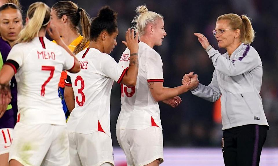 England manager Sarina Wiegman congratulates her players after the 8-0 win over North Macedonia