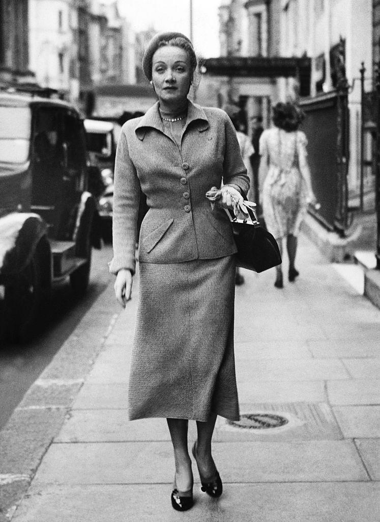 <p>Marlene Dietrich leaving the Claridges Hotel in London, England. <br></p><p>Other celebrity visitors this year: actress Aud Johanssen, Audrey Hepburn, actress Enid Smeedon.</p>