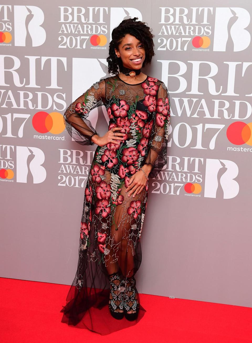 <p>Lianne went for the sheer look in a gorgeous floral design. <i>[Photo: PA]</i> </p>