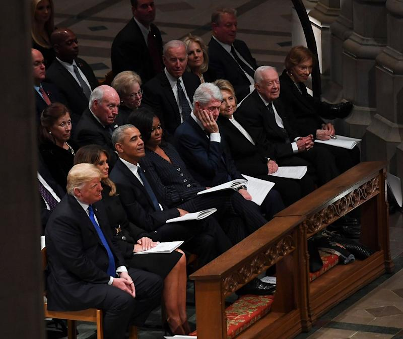 President Donald Trump, First Lady Melania Trump, former President Barack Obama, former First Lady Michelle Obama, former President Bill Clinton, former First Lady Hillary Clinton, and former President Jimmy Carter sit before the funeral service for former US President George H. W. Bush at the National Cathedral in Washington, DC on Dec. 5, 2018.