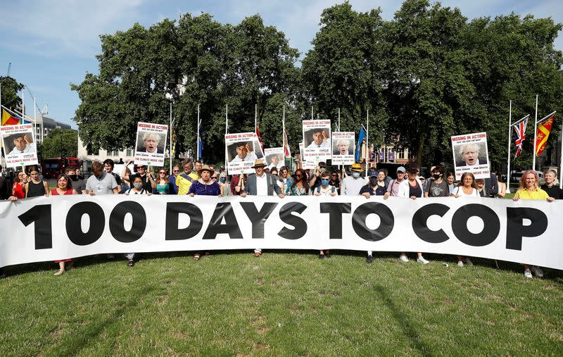 FILE PHOTO: Climate Coalition protesters demonstrate 100 days ahead of the COP26 climate summit, in London