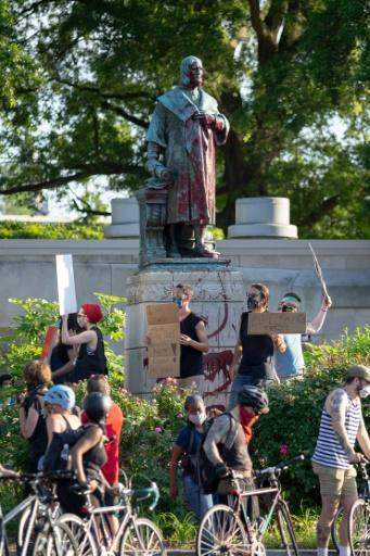 Protesters surround a statue of Christopher Columbus in Richmond, Virginia, before pulling it down