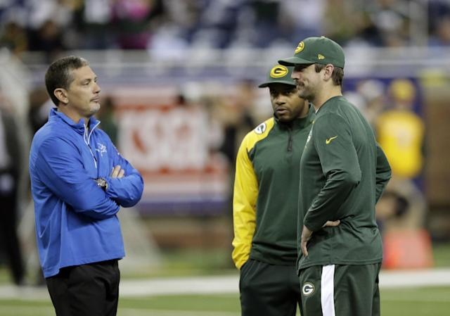 Detroit Lions head coach Jim Schwartz talks with Green Bay Packers wide receiver Randall Cobb, center, and quarterback Aaron Rodgers during a warm up period before an NFL football game at Ford Field in Detroit, Thursday, Nov. 28, 2013. (AP Photo/Carlos Osorio)
