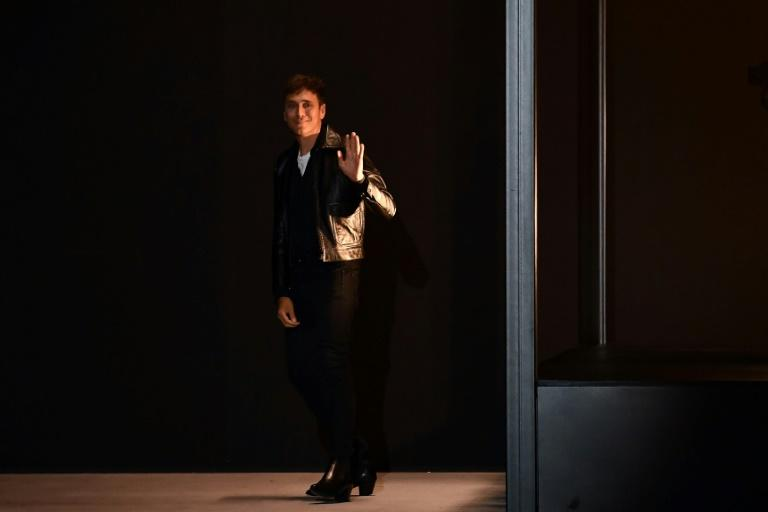 Celine's star designer Hedi Slimane has warned of a new 'puritanism' in the fashion world (AFP Photo/Anne-Christine POUJOULAT)
