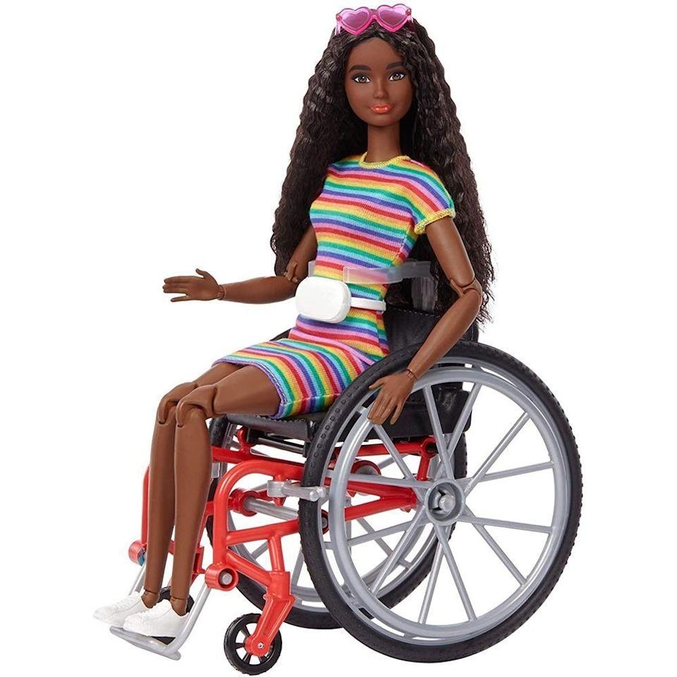 """<p><strong>Barbie</strong></p><p>amazon.com</p><p><strong>$19.88</strong></p><p><a href=""""https://www.amazon.com/dp/B08HG1NWKB?tag=syn-yahoo-20&ascsubtag=%5Bartid%7C2089.g.32781476%5Bsrc%7Cyahoo-us"""" rel=""""nofollow noopener"""" target=""""_blank"""" data-ylk=""""slk:Shop Now"""" class=""""link rapid-noclick-resp"""">Shop Now</a></p><p>A part of the Fashionista line, this Barbie is stylish and cool, and happens to cruise on a neat pair of wheels. Millennial parents are trying to normalize adaptive devices and different abilities, and this Barbie is one step in that direction. </p>"""