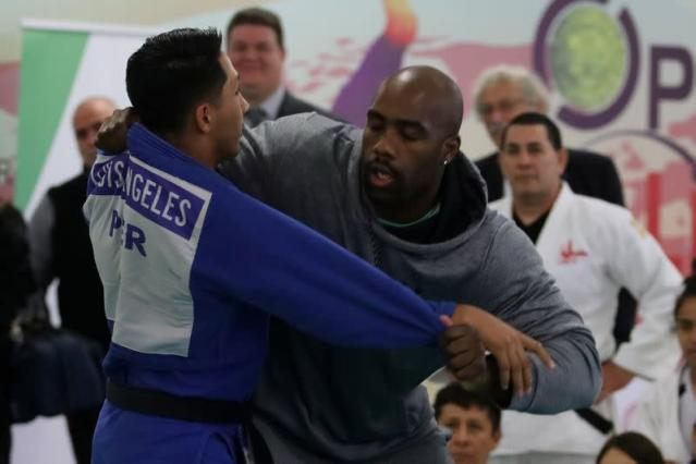 Olympic Judo champion Teddy Riner takes part in a demostration of Judo with Peruvian Judo athletes ahead of the opening of the 131st IOC Session in Lima