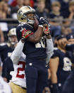 New Orleans Saints wide receiver Brandin Cooks (10) pulls in a pass reception over San Francisco 49ers cornerback Tramaine Brock in the first half of an NFL football game in New Orleans, Sunday, Nov. 9, 2014. (AP Photo/Jonathan Bachman)