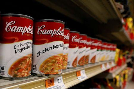 Cans of Campbell's Soup are displayed in a supermarket in New York