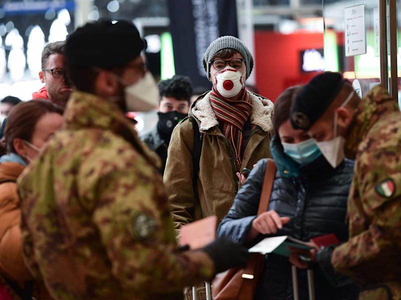 Soldiers wearing masks control passengers arriving at the Milan Central railway station on March 9: AFP/Getty