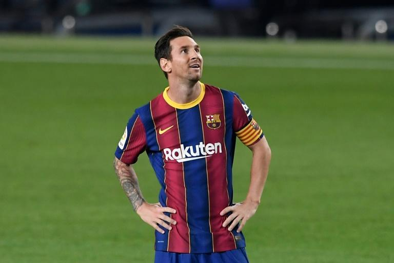 Lionel Messi was all smiles on Sunday despite trying to leave Barcelona in the close season