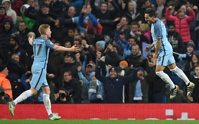 Manchester City's Ilkay Gundogan (right) celebrates scoring his team's third goal against Barcelona with team-mate Kevin De Bruyne on November 1, 2016 (AFP Photo/Paul Ellis )