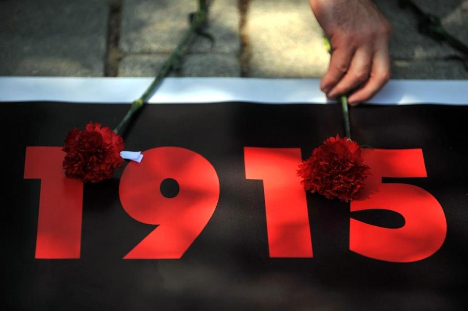 Cypriot parliament unanimously approved a law that makes it a crime to deny that mass killings of Armenians under the Ottoman Empire in 1915 amounted to genocide (AFP Photo/Ozan Kose)