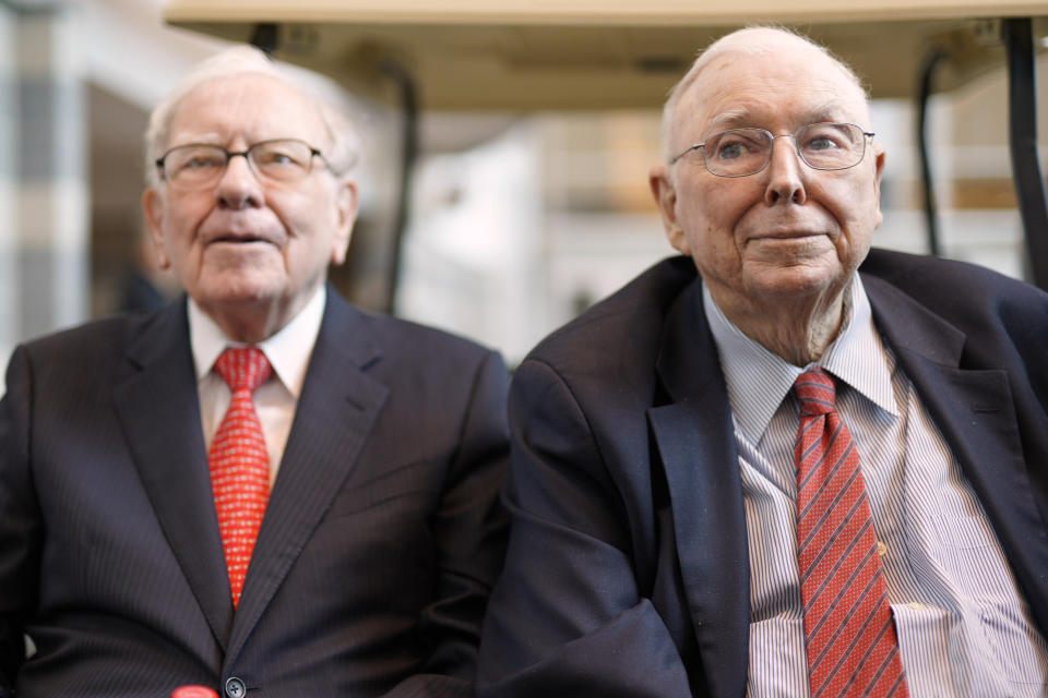 Vice Chairman Charlie Munger, right, sits next to Berkshire Hathaway Chairman and CEO Warren Buffett, as they briefly chat with reporters Friday, May 3, 2019, one day before Berkshire Hathaway's annual shareholders meeting. An estimated 40,000 people are expected in town for the event, where Buffett and Munger preside over the meeting and spend hours answering questions. (AP Photo/Nati Harnik)