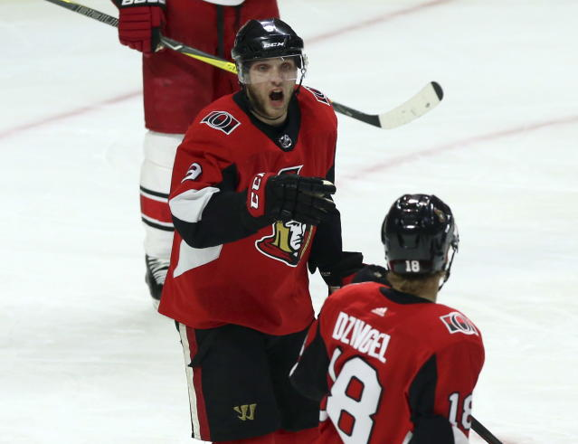 Ottawa Senators' Bobby Ryan celebrates his goal against the Carolina Hurricanes with teammate Ryan Dzingel (18) during first-period NHL hockey game action in Ottawa, Ontario, Saturday, March 24, 2018. (Fred Chartrand/The Canadian Press via AP)