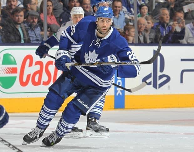 Daniel Winnik, who played for the Toronto Maple Leafs as part of his 11-year NHL career, says Canadians playing in leagues overseas should be designated as essential travelers. (Getty Images - image credit)