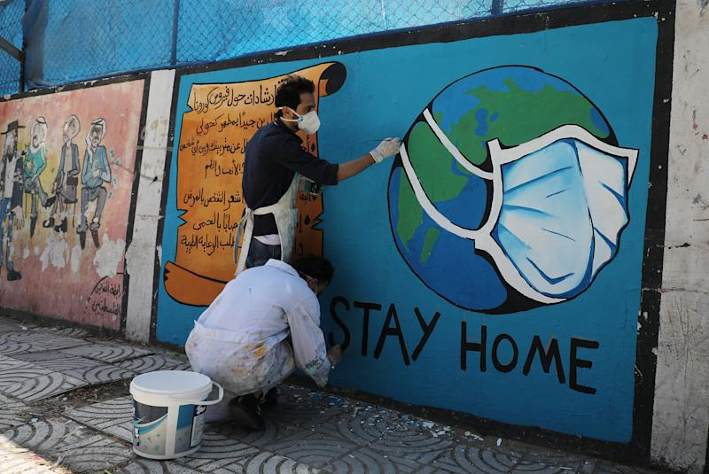 Palestinian artists draw a mural during awareness campaign about the coronavirus COVID-19, in Gaza on April 2,2020. | Majdi Fathi–NurPhoto/ Getty Images