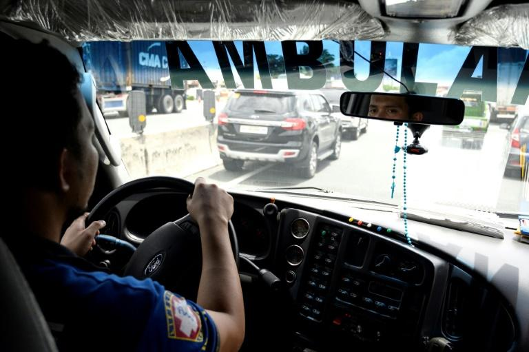 Ambulance driver Joseph Laylo driving says Manila's traffic congestion may be causing patients to die en route to hospital