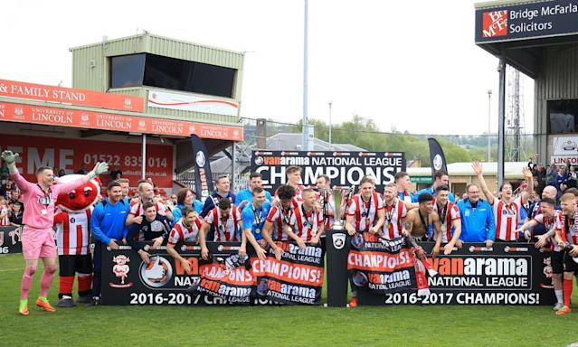 "<span class=""element-image__caption"">The party begins for Lincoln City, with their victory over Macclesfield securing promotion and the title.</span> <span class=""element-image__credit"">Photograph: Nigel French/PA</span>"