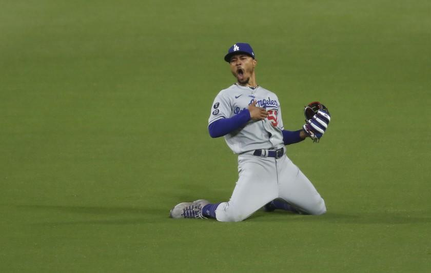 Los Angeles Dodgers' Mookie Betts celebrates after making a diving catch