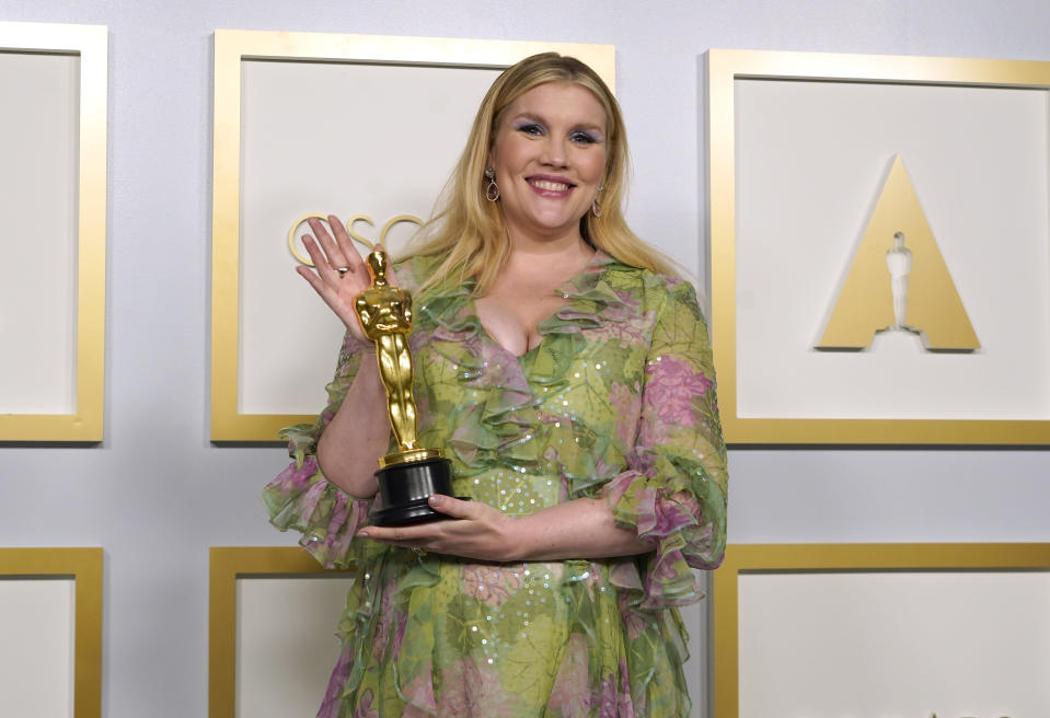 """Emerald Fennell, winner of the award for best original screenplay for """"Promising Young Woman,"""" poses in the press room at the Oscars on Sunday, April 25, 2021, at Union Station in Los Angeles. (AP Photo/Chris Pizzello, Pool)"""