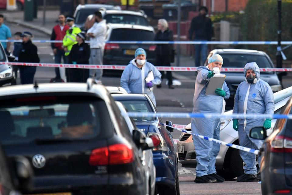 Police in Wood Green after the stabbing (PA)