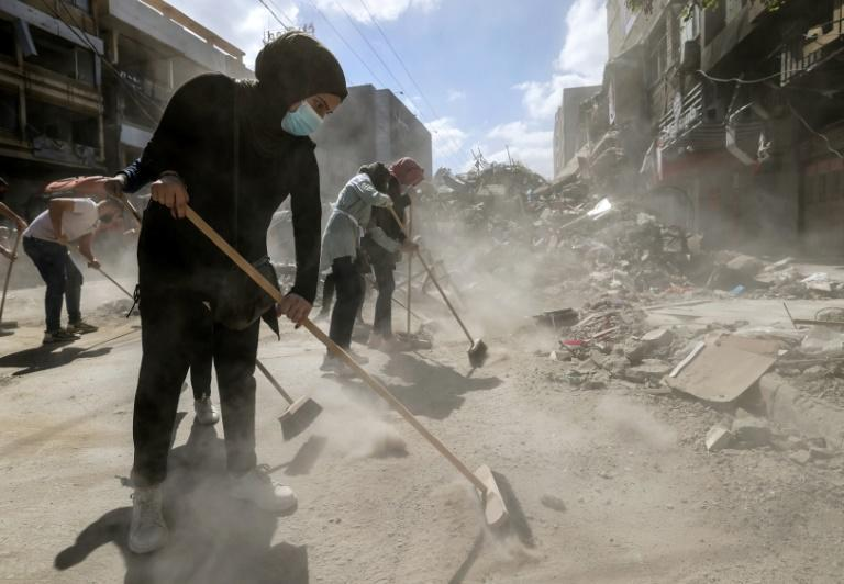 Palestinian volunteers clear the rubble in Gaza on Sunday