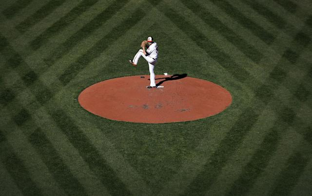Baltimore Orioles starting pitcher Chris Tillman throws to the Boston Red Sox in the third inning of an opening day baseball game, Monday, March 31, 2014, in Baltimore. (AP Photo/Patrick Semansky)