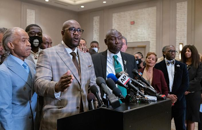 """George Floyd's brother Philonise Floyd is flanked by the Rev. Al Sharpton, left, and Attorney Ben Crump during a news conference after the verdicts were announced.<span class=""""copyright"""">Ruddy Roye for TIME</span>"""