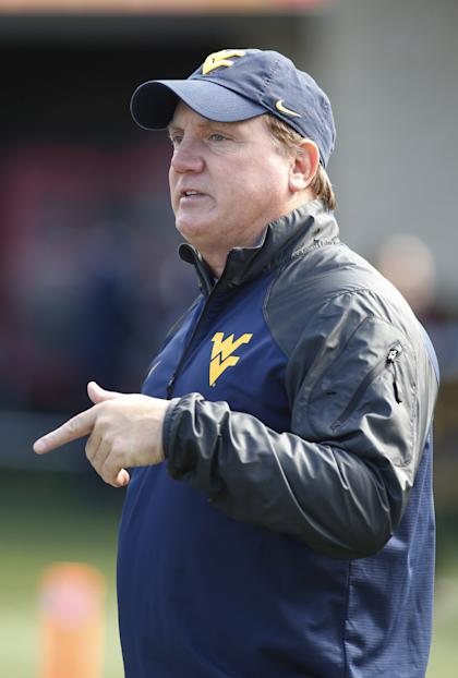 Oct 4, 2014; Morgantown, WV, USA; West Virginia Mountaineers associate head coach/defensive line coach Tom Bradley gestures on the field before the Mountaineers host the Kansas Jayhawks at Milan Puskar Stadium. (Charles LeClaire-USA TODAY Sports)