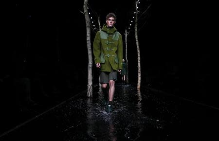 A model presents a creation from the Hunter Autumn/Winter 2014 collection during London Fashion Week