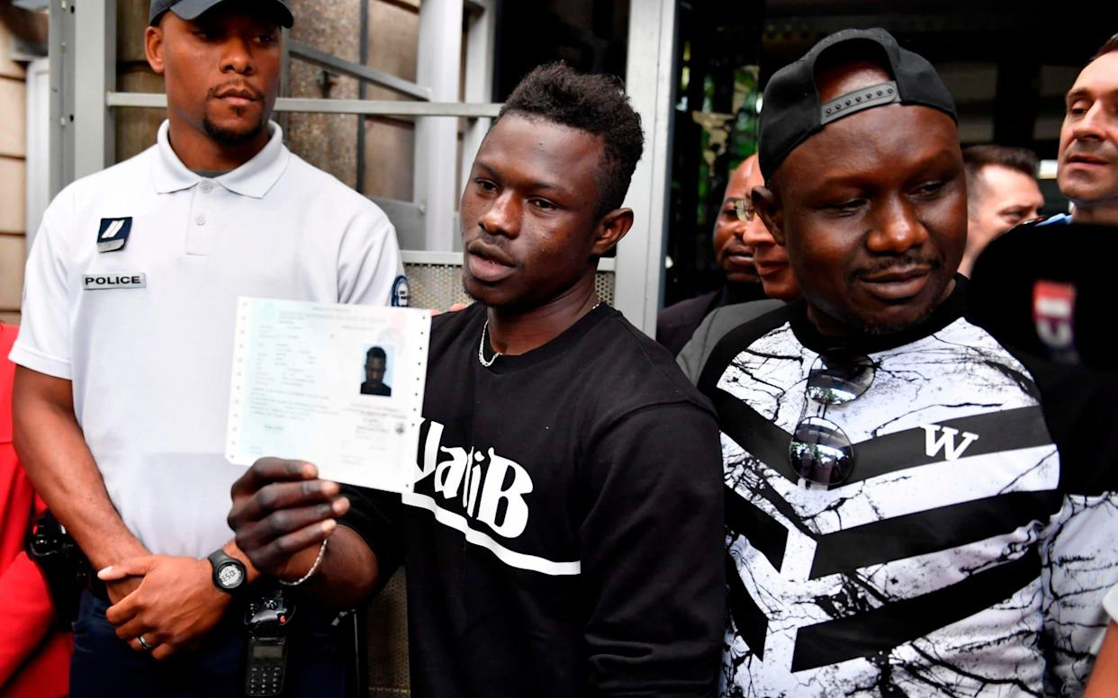 Malian migrant Mamoudou Gassama has received thanks from the family of the boy he rescued - AFP