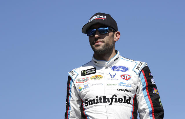 """<a class=""""link rapid-noclick-resp"""" href=""""/nascar/sprint/drivers/1361/"""" data-ylk=""""slk:Aric Almirola"""">Aric Almirola</a> is introduced prior to the NASCAR Cup Series 300 auto race at New Hampshire Motor Speedway in Loudon, N.H., Sunday, Sept. 24, 2017. (AP Photo/Charles Krupa)"""