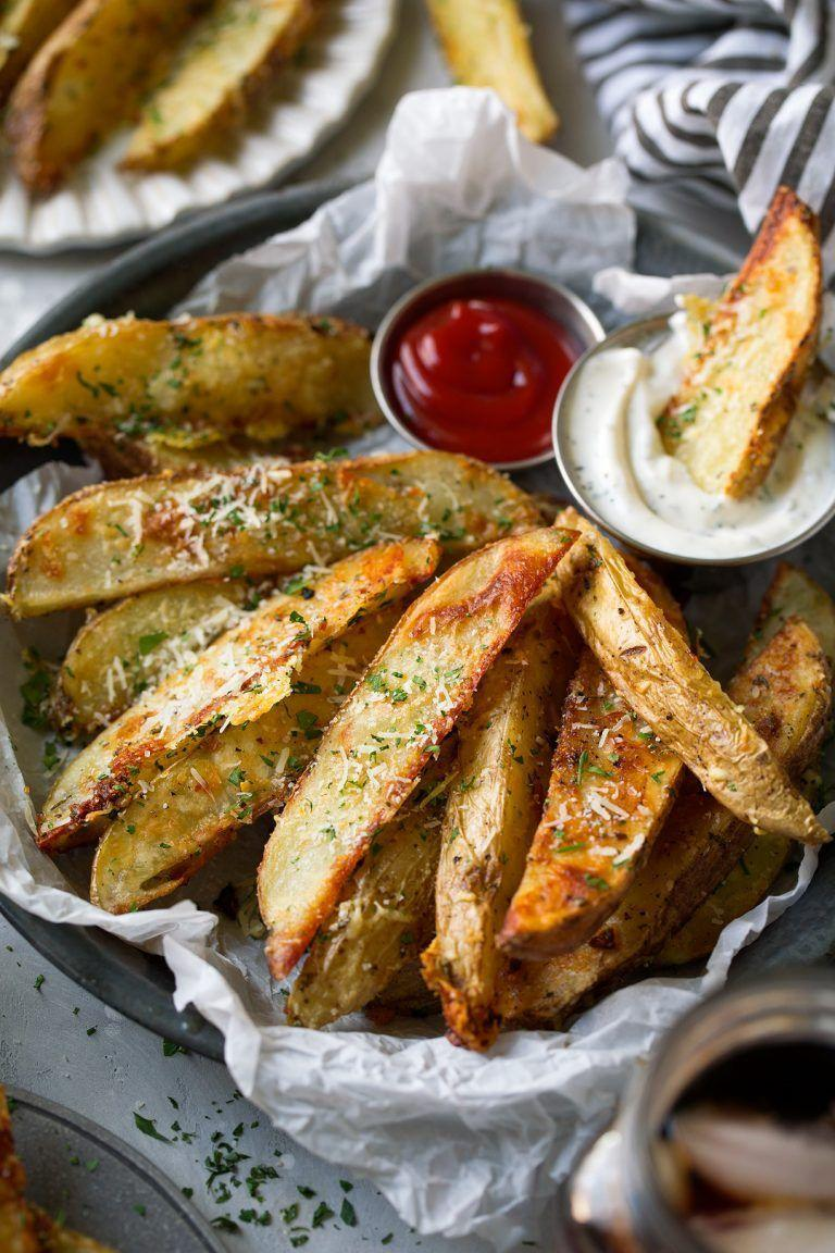 "<p>Your Super Bowl guests will devour these Parmesan potato wedges that they can dip in the homemade creamy basil sauce.</p><p><strong>Get the recipe at <a href=""https://www.cookingclassy.com/baked-garlic-parmesan-potato-wedges/"" rel=""nofollow noopener"" target=""_blank"" data-ylk=""slk:Cooking Classy"" class=""link rapid-noclick-resp"">Cooking Classy</a>.</strong></p><p><strong><strong><a class=""link rapid-noclick-resp"" href=""https://www.amazon.com/Nordic-Ware-Natural-Aluminum-Commercial/dp/B0049C2S32/?tag=syn-yahoo-20&ascsubtag=%5Bartid%7C10050.g.2966%5Bsrc%7Cyahoo-us"" rel=""nofollow noopener"" target=""_blank"" data-ylk=""slk:SHOP BAKING SHEETS"">SHOP BAKING SHEETS</a></strong><br></strong></p>"