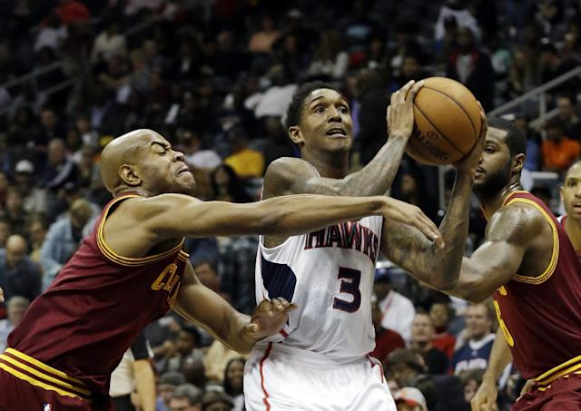 Atlanta Hawks shooting guard Louis Williams (3) drives against Cleveland Cavaliers point guard Jarrett Jack in the first half of an NBA basketball game Friday, Dec. 6, 2013, in Atlanta. (AP Photo/John Bazemore)