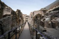 """A view of the newly restored lower level of the Colosseum, in Rome, Friday, June 25, 2021. After 2-and-1/2 years of work to shore up the Colosseum's underground passages, tourists will be able to go down and wander through part of what what had been the ancient arena's """"backstage."""" (AP Photo/Andrew Medichini)"""