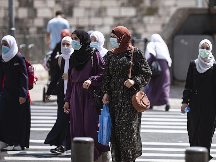"Women wear face masks as a preventive measure against the coronavirus (COVID-19) pandemic in Jerusalem on September 10, 2020. <p class=""copyright"">Mostafa Alkharouf/Anadolu Agency via Getty Images</p>"