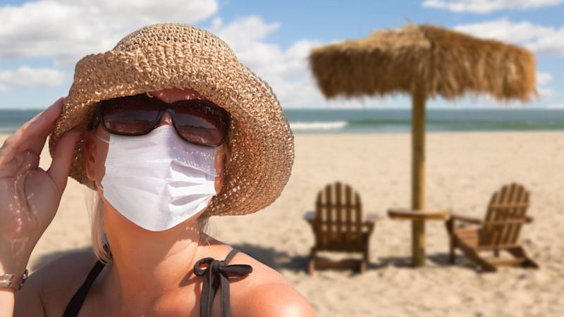 Woman wearing mask on the beach