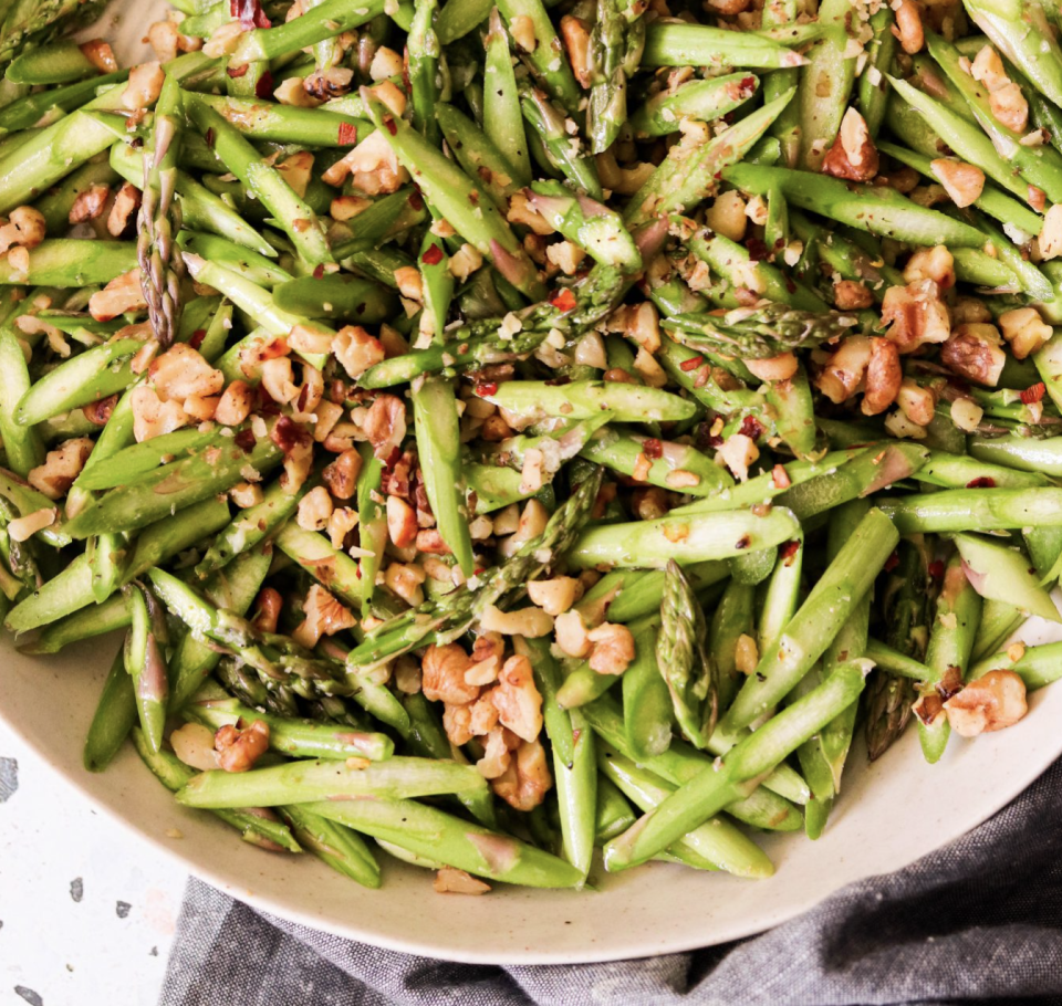 """<p>Asparagus are a crunchy, tasty treat to add to any dish from your starter salad to the main entree. ICYDK, they're also packed with Vitamin A and C. To make this salad truly a raw vegan dish, keep the walnuts off the skillet and soak them to soften up instead.<br></p><p><a class=""""link rapid-noclick-resp"""" href=""""https://whatgreatgrandmaate.com/raw-asparagus-salad-paleo-whole30-vegan-low-carb/#recipe"""" rel=""""nofollow noopener"""" target=""""_blank"""" data-ylk=""""slk:Get the recipe"""">Get the recipe</a></p><p><em>Per serving: 185 cal, 17 g fat (2 g saturated fat), 8 g carbs, 3 g sugar, 76 mg sodium, 4 g fiber, 5 g protein</em></p>"""
