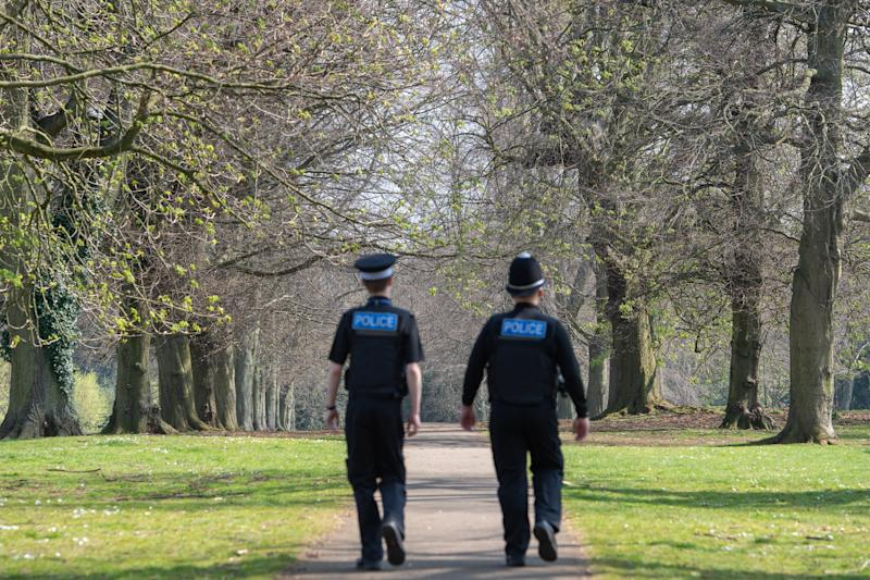 Police officers patrol a park in Northampton, as Northants Police announce they are toughening up their social distancing enforcement, as the UK continues in lockdown to help curb the spread of Covid-19.