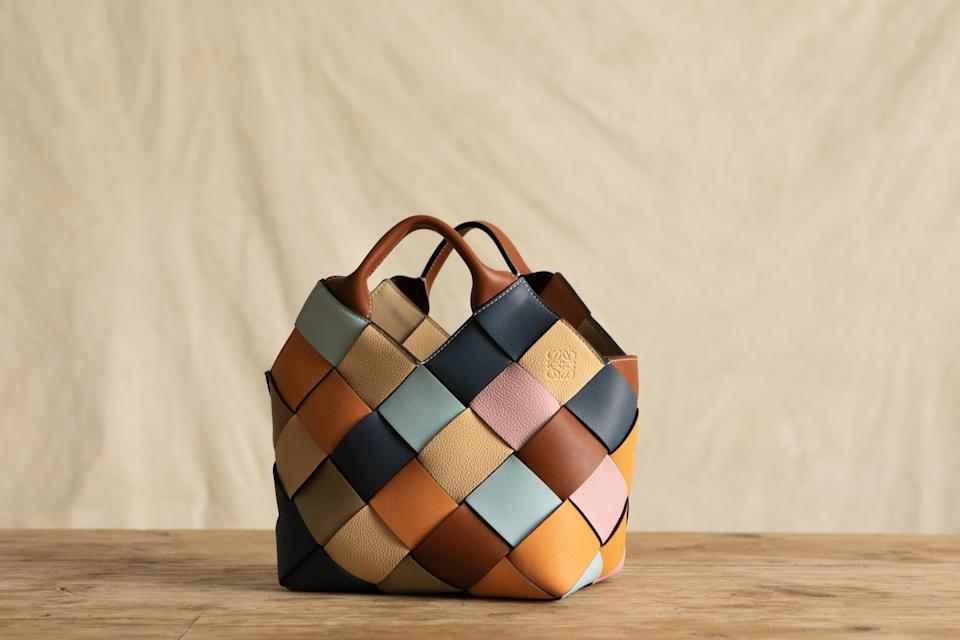 """<p>Loewe is launching a new sustainable version of one of its best-known handbags, the woven basket bag, which has been made entirely from surplus materials. The fashion house is taking a step towards circular fashion with this project, where the team has crafted the accessories from unused leather from previous seasons.</p><p>""""The surplus project is a display in how to re-use, re-think and re-create something beautiful from the excess material of previous collections,"""" the brand said. """"The new project sees the two most iconic of Loewe's leathers — a smooth, classic calfskin, and a finely textured, soft-grained calfskin — given a new lease of life as woven basket bags and a crab charm.""""</p><p>The woven bag is one of the house's most popular styles. It appeared in Jonathan Anderson's first collection for Loewe (spring/summer 2015) and has since become a design classic for the brand. This is not the first time the house has turned to surplus materials – Loewe recently launched a collection using recycled, upcycled and organic textiles in an eyewear collection.</p><p>Below, watch the design process in action, where you can see how the leather is cut into narrow strips and then braided together in a lattice formation to create a mosaic-like rainbow of colour and texture. <a href=""""https://www.loewe.com/eur/en/women/surplus-leather"""" rel=""""nofollow noopener"""" target=""""_blank"""" data-ylk=""""slk:And to shop the bags and the charms, head here"""" class=""""link rapid-noclick-resp"""">And to shop the bags and the charms, head here</a>.</p>"""